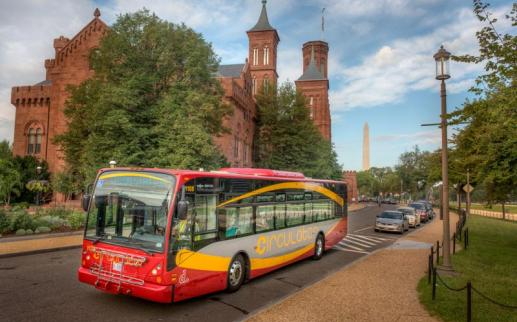 DC Circulator bus on the National Mall in front of the Smithsonian Castle - How to get around Washington, DC