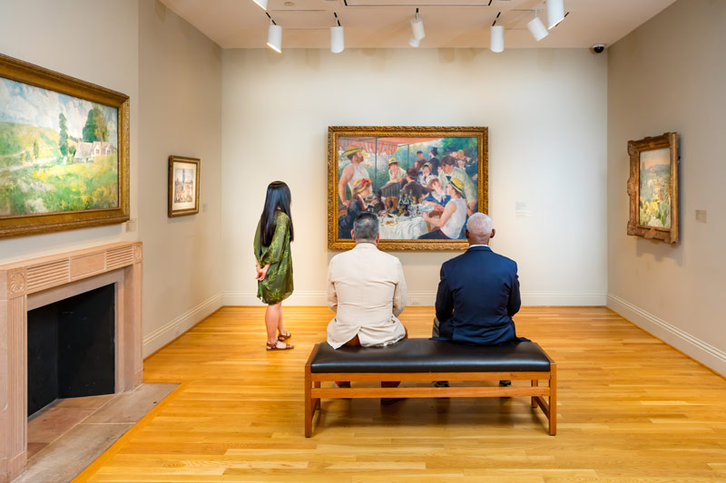 Visitors viewing 'Luncheon of the Boating Party' by Renoir at The Phillips Collection in Washington, DC's Dupont Circle neighborhood